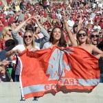 Oct 5, 2013; Berkeley, CA, USA; Washington State Cougars female fans wave a flag during the game against the California Golden Bears at Memorial Stadium. Washington State defeated California 44-22. Mandatory Credit: Kirby Lee-USA TODAY Sports