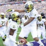 Oct 12, 2013; Seattle, WA, USA; Oregon Ducks wide receiver Keanon Lowe (7) and wide receiver Bralon Addison (11) celebrate after Addison caught a pass for a touchdown against the Washington Huskies at Husky Stadium. Mandatory Credit: Steven Bisig-USA TODAY Sports