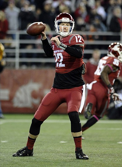 Oct 12, 2013; Pullman, WA, USA; Washington State Cougars quarterback Connor Halliday (12) drops back for a pass against the Oregon State Beavers at Martin Stadium. Mandatory Credit: James Snook-USA TODAY Sports