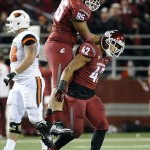 Oct 12, 2013; Pullman, WA, USA; Washington State Cougars nose tackle Ioane Gauta (95) and linebacker Cyrus Coen (42) celebrate a sack against the Oregon State Beavers during the second half at Martin Stadium. The Beavers beat the Cougars 52-24. Mandatory Credit: James Snook-USA TODAY Sports