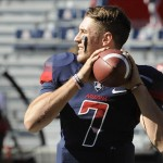 Nov 16, 2013; Tucson, AZ, USA; Arizona Wildcats quarterback B.J. Denker (7) warms up before the first quarter against the Washington State Cougars at Arizona Stadium. Mandatory Credit: Casey Sapio-USA TODAY Sports