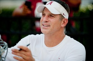Aug 4, 2013; Tuscaloosa, AL, USA; Alabama Crimson Tide defensive coordinator Doug Nussmeier signs autographs following practice at Bryant Denny Stadium. Mandatory Credit: Kevin Liles-USA TODAY Sports