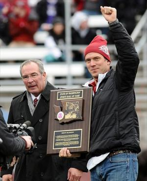 Nov. 23, 2012; Pullman, WA, USA; Washington State Cougars alumni Drew Bledsoe (right) gets inducted into the State of Washington Sports Hall of Fame during the first half against the Washington Huskies at Martin Stadium. Mandatory Credit: James Snook-USA TODAY Sports