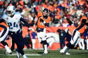 Dec 8, 2013; Denver, CO, USA; Denver Broncos quarterback Peyton Manning (18) throws in the first quarter against the Tennessee Titans at Sports Authority Field at Mile High. The Broncos defeated the Titans 51-28. Mandatory Credit: Ron Chenoy-USA TODAY Sports