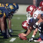 Oct 5, 2013; Berkeley, CA, USA; General view of the line of scrimmage as Washington State Cougars long snapper Alex Den Bleyker (65) snaps the ball against the California Golden Bears at Memorial Stadium. Washington State defeated California 44-22. Mandatory Credit: Kirby Lee-USA TODAY Sports