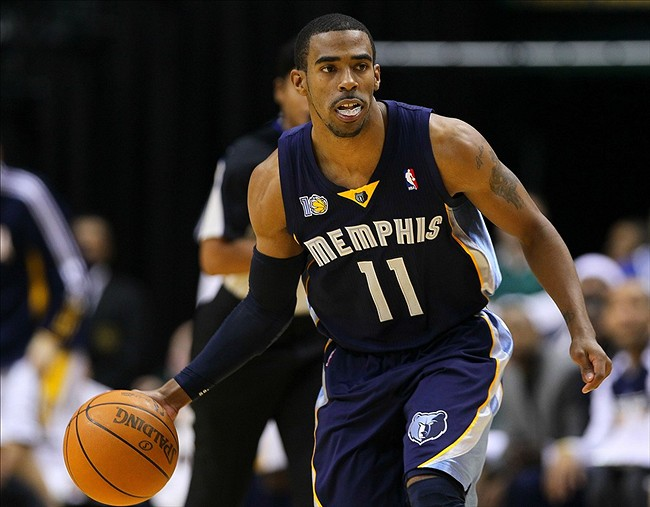 Dec. 26, 2010; Indianapolis, IN, USA; Memphis Grizzlies point guard Mike Conley (11) brings the ball up court against the Indiana Pacers at Conseco Fieldhouse. Memphis defeated Indiana 104-90. Mandatory credit: Michael Hickey-US PRESSWIRE