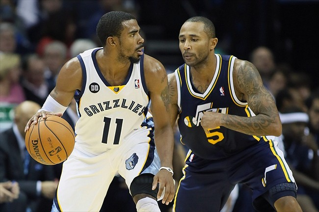 Nov 5, 2012; Memphis, TN, USA; Memphis Grizzlies guard Mike Conley (11) drives against Utah Jazz guard Mo Williams (5) at the FedEx Forum. Memphis defeated Utah 103-94. Mandatory Credit: Nelson Chenault-USA TODAY Sports