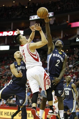 Dec 22, 2012; Houston, TX, USA; Memphis Grizzlies point guard Josh Selby (2) blocks the shot of Houston Rockets point guard Jeremy Lin (7) in the fourth quarter at the Toyota Center. The Rockets defeated the Grizzlies 121-96. Mandatory Credit: Brett Davis-USA TODAY Sports