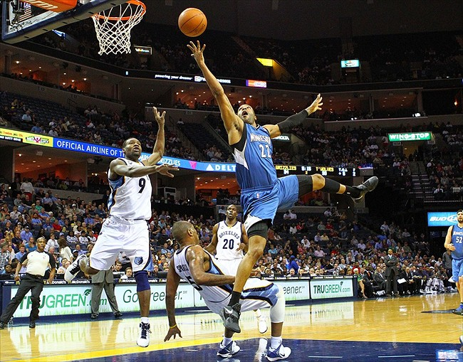 Mar 27, 2012; Memphis, TN, USA; Minnesota Timberwolves guard Wayne Ellington (22) shoots the ball while drawing a foul from Memphis Grizzlies center Marreese Speights (5) during the first half at the FedEx Forum. Mandatory Credit: Spruce Derden-USA TODAY Sports