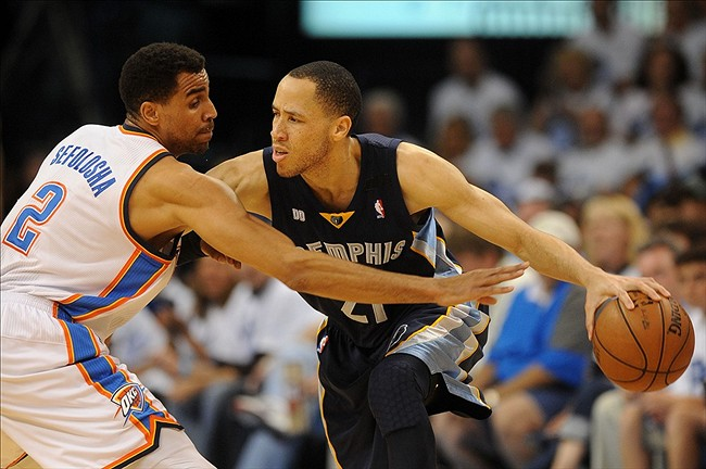 May 15, 2013; Oklahoma City, OK, USA; Memphis Grizzlies forward Tayshaun Prince (21) handles the ball against Oklahoma City Thunder guard Thabo Sefolosha (2) during the second half in game five of the second round of the 2013 NBA Playoffs at Chesapeake Energy Arena. The Grizzlies defeated the Thunder 88-84. Mandatory Credit: Mark D. Smith-USA TODAY Sports