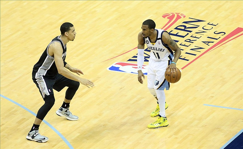 May 27, 2013; Memphis, TN, USA; Memphis Grizzlies point guard Mike Conley (11) brings the ball up court against San Antonio Spurs shooting guard Danny Green in the first half of game four of the Western Conference finals of the 2013 NBA Playoffs at FedEx Forum. Mandatory Credit: Nelson Chenault-USA TODAY Sports