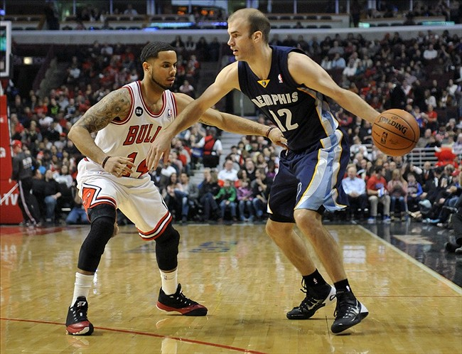 Mar 7, 2014; Chicago, IL, USA; Memphis Grizzlies shooting guard Nick Calathes (12) is guarded by Chicago Bulls point guard D.J. Augustin (14) during the first half at the United Center. Mandatory Credit: David Banks-USA TODAY Sports