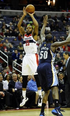 Mar 3, 2014; Washington, DC, USA; Washington Wizards power forward Trevor Booker (35) shoots over Memphis Grizzlies power forward Zach Randolph (50) during the first half at Verizon Center. Mandatory Credit: Brad Mills-USA TODAY Sports