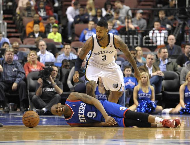Mar 15, 2014; Philadelphia, PA, USA; Philadelphia 76ers guard James Anderson (9) lies on the floor in pain after being injured against Memphis Grizzlies forward James Johnson (3) during the second half at Wells Fargo Center. The Grizzlies defeated the 76ers, 103-77. Mandatory Credit: Eric Hartline-USA TODAY Sports