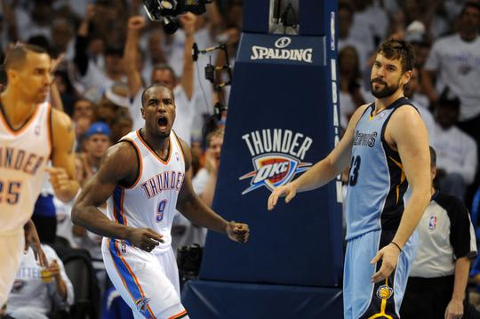 Apr 21, 2014; Oklahoma City, OK, USA; Oklahoma City Thunder forward Serge Ibaka (9) and Memphis Grizzlies center Marc Gasol (33) react after a dunk during the second quarter in game two during the first round of the 2014 NBA Playoffs at Chesapeake Energy Arena. Mandatory Credit: Mark D. Smith-USA TODAY Sports