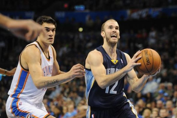 Feb 3, 2014; Oklahoma City, OK, USA; Memphis Grizzlies shooting guard Nick Calathes (12) handles the ball against Oklahoma City Thunder center Steven Adams (12) during the second quarter at Chesapeake Energy Arena. Mandatory Credit: Mark D. Smith-USA TODAY Sports