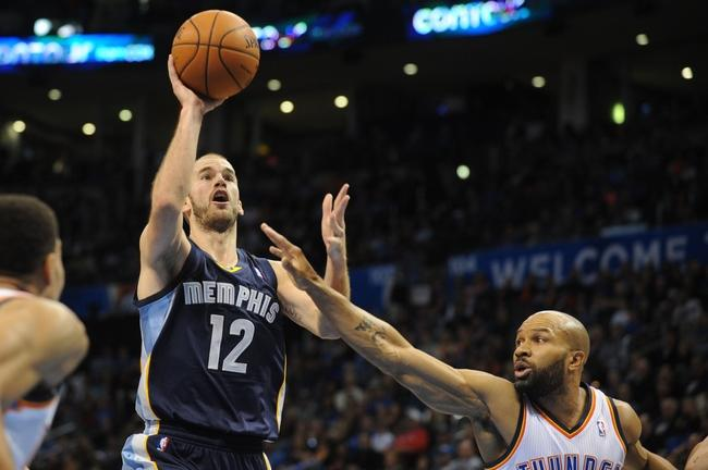 Feb 3, 2014; Oklahoma City, OK, USA; Memphis Grizzlies shooting guard Nick Calathes (12) attempts a shot against Oklahoma City Thunder point guard Derek Fisher (6) during the second quarter at Chesapeake Energy Arena. Mandatory Credit: Mark D. Smith-USA TODAY Sports