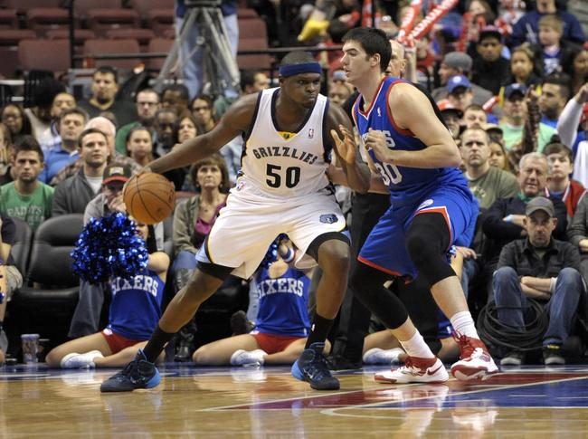 Mar 15, 2014; Philadelphia, PA, USA; Memphis Grizzlies forward Zach Randolph (50) drives against Philadelphia 76ers center Byron Mullens (30) during the second half at Wells Fargo Center. The Grizzlies defeated the 76ers, 103-77. Mandatory Credit: Eric Hartline-USA TODAY Sports