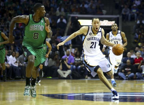 Mar 23, 2013; Memphis, TN, USA; Memphis Grizzlies small forward Tayshaun Prince (21) brings the ball up court while guarded by Boston Celtics power forward Jeff Green (8) during the game at FedEx Forum. Memphis Grizzlies defeat the Boston Celtics 110-106. Mandatory Credit: Spruce Derden-USA TODAY Sports