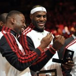Oct 30, 2012; Miami, FL, USA; Miami Heat shooting guard Dwyane Wade (left) and small forward LeBron James (right) celebrate after receiving their NBA championship rings before a game against the Boston Celtics at American Airlines Arena. Mandatory Credit: Steve Mitchell-US PRESSWIRE