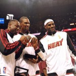 Oct 30, 2012; Miami, FL, USA; Miami Heat shooting guard Dwyane Wade (left) - power forward Chris Bosh (center) - small forward LeBron James (right) after receiving their NBA championship rings before a game against the Boston Celtics at American Airlines Arena. Mandatory Credit: Steve Mitchell-US PRESSWIRE