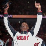 Oct 30, 2012; Miami, FL, USA; Miami Heat shooting guard Dwyane Wade (3) reacts after receiving his NBA championship ring before a game against the Boston Celtics at American Airlines Arena. The Heat won 120-107. Mandatory Credit: Steve Mitchell-US PRESSWIRE