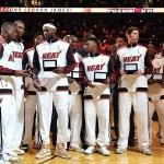 Oct 30, 2012; Miami, FL, USA; Miami Heat shooting guard Dwyane Wade (far left) - power forward Chris Bosh (second from left) - small forward LeBron James (third from left) and teammates celebrate after receiving their NBA championship rings before a game against the Boston Celtics at American Airlines Arena. The Heat won 120-107. Mandatory Credit: Steve Mitchell-US PRESSWIRE