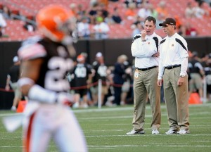 August 13, 2011; Cleveland, OH, USA; Cleveland Browns head coach Pat Shurmur (left) and defensive coordinator Dick Jauron (right) before the game against the Green Bay Packers at Cleveland Browns Stadium. Mandatory Credit: Eric P. Mull-USA TODAY Sports