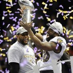 Feb 3, 2013; New Orleans, LA, USA; Baltimore Ravens free safety Ed Reed (20) celebrates with inside linebacker Ray Lewis and the Vince Lombardi Trophy after defeating the San Francisco 49ers in Super Bowl XLVII at the Mercedes-Benz Superdome. Mandatory Credit: Robert Deutsch-USA TODAY Sports