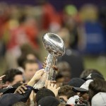 Feb 3, 2013; New Orleans, LA, USA; The Raven pass aloft the Vince Lombardi trophy after winning Super Bowl XLVII at the Mercedes-Benz Superdome. Mandatory Credit: Jack Gruber-USA TODAY Sports