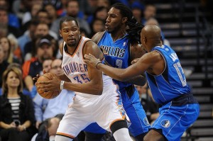 Feb 4, 2013; Oklahoma City, OK, USA; Oklahoma City Thunder forward Kevin Durant (35) handles the ball against Dallas Mavericks forward Jae Crowder (9) and mavericks guard Mike James (13) during the second half at the Chesapeake Energy Arena.  Mandatory Credit: Mark D. Smith-USA TODAY Sports