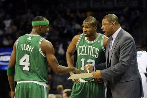 February 11, 2013; Charlotte, NC, USA; Boston Celtics head coach Doc Rivers talks to guard Jason Terry (4) and guard Leandro Barbosa (12) in a time out during the game against the Charlotte Bobcats at Time Warner Cable Arena. Mandatory Credit: Sam Sharpe-USA TODAY Sports
