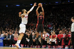 Feb 13, 2013; New York, NY, USA; Toronto Raptors shooting guard Alan Anderson (6) takes a shot over New York Knicks center Tyson Chandler (6) during the first half at Madison Square Garden. Mandatory Credit: Joe Camporeale-USA TODAY Sports