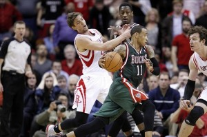 Feb 27, 2013; Houston, TX, USA; Milwaukee Bucks point guard Monta Ellis (11) drives past Houston Rockets small forward Chandler Parsons (25) during the second half at the Toyota Center. The Bucks won 110-107. Mandatory Credit: Thomas Campbell-USA TODAY Sports