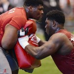 Mar 13, 2013; Tuscaloosa, AL, USA; Alabama Crimson Tide offensive linemen D.J. Fluker (left) and Chance Warmack do bag drills during Alabama pro day at the Mal M. Moore Athletic Facility. Mandatory Credit: Kelly Lambert-USA TODAY Sports