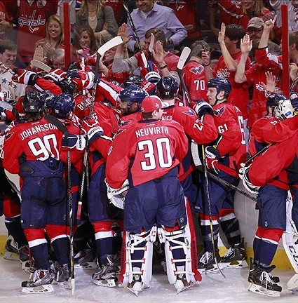 May 4, 2013; Washington, DC, USA; Washington Capitals players celebrate after their game against the New York Rangers in game two of the first round of the 2013 Stanley Cup playoffs at Verizon Center. The Capitals won 1-0 in overtime. Mandatory Credit: Geoff Burke-USA TODAY Sports