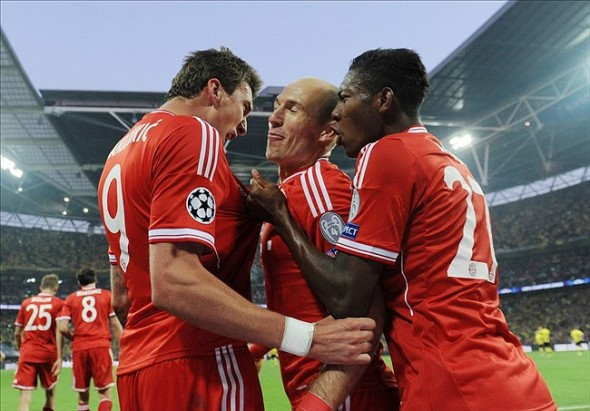 May 25, 2013; London, UNITED KINGDOM; Bayern Munich player Mario Mandzukic (left) celebrates with teammates including Arjen Robben (middle) after scoring a goal against Borussia Dortmund in the second half during the Champions League final at Wembley Stadium. Mandatory Credit: Tim Groothuis/Witters Sport via USA TODAY Sports