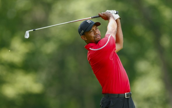 DUBLIN, OH - JUNE 02: Tiger Woods hits his approach shot on the 13th hole during the final round of the Memorial Tournament presented by Nationwide Insurance at Muirfield Village Golf Club on June 2, 2013 in Dublin, Ohio. (Photo by Scott Halleran/Getty Images)