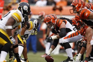 Nov 13, 2011; Cincinnati, OH, USA; Cincinnati Bengals center Kyle Cook (64) lines up during the second half against the Pittsburgh Steelers at Paul Brown Stadium. The Steelers defeated the Bengals 24-17. Mandatory Credit: Frank Victores-USA TODAY Sports