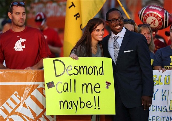 Sep 1, 2012; Arlington, TX, USA; ESPN analyst Desmond Howard takes a photo with a fan on the set of ESPN College Gameday before the game between the Alabama Crimson Tide and the Michigan Wolverines at Cowboys Stadium. Mandatory Credit: Kevin Jairaj-USA TODAY Sports