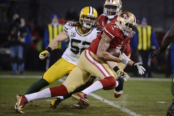Jan 12, 2013; San Francisco, CA, USA; San Francisco 49ers quarterback Colin Kaepernick (7) runs the ball against Green Bay Packers outside linebacker Clay Matthews (52) during the second quarter of the NFC divisional round playoff game at Candlestick Park. Mandatory Credit: Robert Hanashiro-USA TODAY Sports