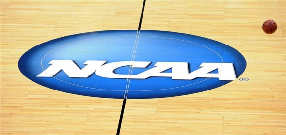 Mar 20, 2013; Salt Lake City, UT, USA; A ball bounces through the NCAA logo during practice the day before the second round of the 2013 NCAA tournament at EnergySolutions Arena. Mandatory Credit: Steve Dykes-USA TODAY Sports
