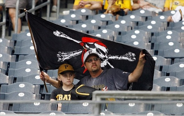 Jun 30, 2013; Pittsburgh, PA, USA; Pittsburgh Pirates fans Allie Teagle (left) and her dad Eric Teagle wait out a rain delay during the second inning between the Milwaukee Brewers and Pittsburgh Pirates at PNC Park. Mandatory Credit: Charles LeClaire-USA TODAY Sports