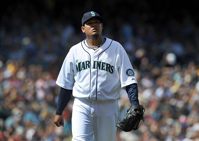 Aug 11, 2013; Seattle, WA, USA; Seattle Mariners starting pitcher Felix Hernandez (34) walks off the field after the 8th inning of the game against the Milwaukee Brewers at Safeco Field. The Mariners won 2-0. Mandatory Credit: Steve Dykes-USA TODAY Sports
