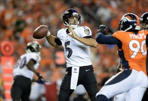 Sep 5, 2013; Denver, CO, USA; Baltimore Ravens quarterback Joe Flacco (5) prepares to pass in the fourth quarter against the Denver Broncos at Sports Authority Field at Mile High. The Broncos defeated the Ravens 49-27. Mandatory Credit: Ron Chenoy-USA TODAY Sports