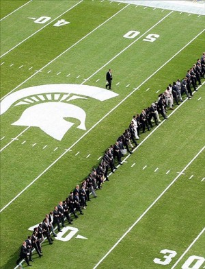 Sep 7, 2013; East Lansing, MI, USA; Michigan State Spartans head coach Mark Dantonio and his team walk the field prior to a game against the South Florida Bulls at Spartan Stadium. Mandatory Credit: Mike Carter-USA TODAY Sports