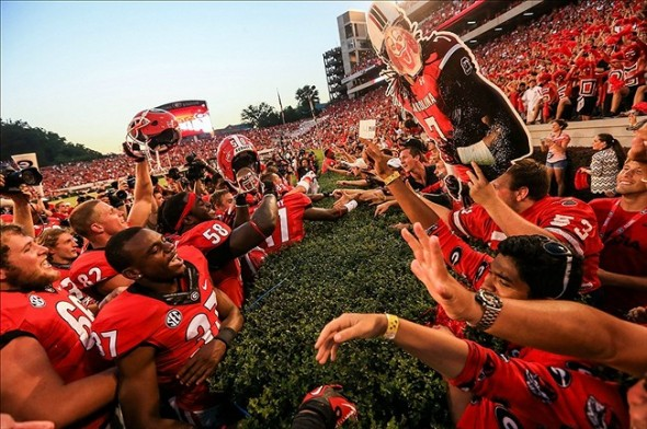 Sep 7, 2013; Athens, GA, USA; Georgia Bulldogs players celebrate with fans after beating the South Carolina Gamecocks at Sanford Stadium. Georgia won 41-30. Mandatory Credit: Daniel Shirey-USA TODAY Sports