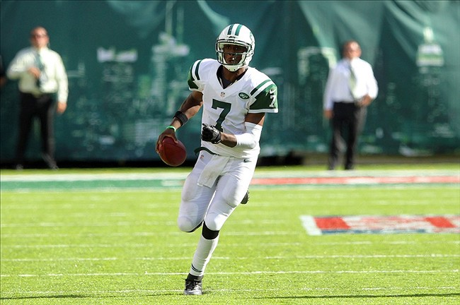 Sep 8, 2013; East Rutherford, NJ, USA; New York Jets quarterback Geno Smith (7) scrambles to set up the game-winning field goal against the Tampa Bay Buccaneers during the fourth quarter of a game at MetLife Stadium. The Jets won 18-17. Mandatory Credit: Brad Penner-USA TODAY Sports