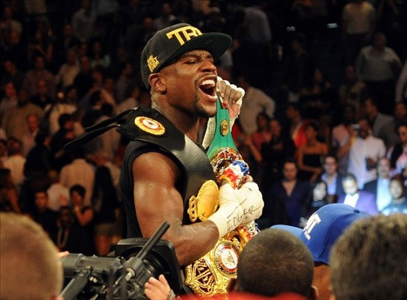 Sep 14, 2013; Las Vegas, NV, USA; Floyd Mayweather Jr. celebrates after defeating Canelo Alvarez by a majority decision at their WBC and WBA super welterweight titles fight at MGM Grand Garden Arena. Mandatory Credit: Jayne Kamin-Oncea-USA TODAY Sports