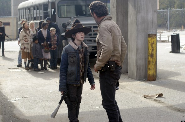 Carl Grimes (Chandler Riggs) and Rick Grimes (Andrew Lincoln) - The Walking Dead - Season 3, Episode 16 - Photo Credit: Gene Page/AMC
